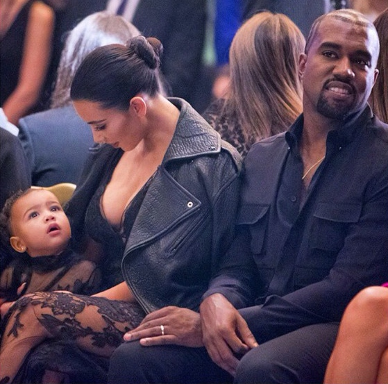 Kim Kardashian West, Kanye West, and North West at the Givenchy SS15 show