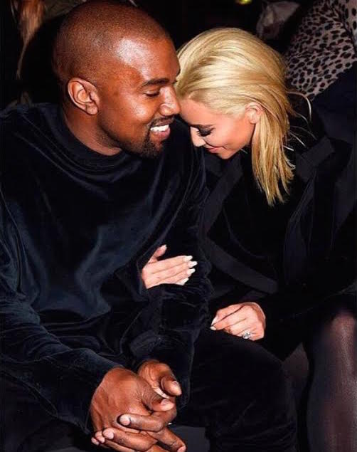 Kim Kardashian West with her hubby in her new hair doo at the Balmain show today in Paris