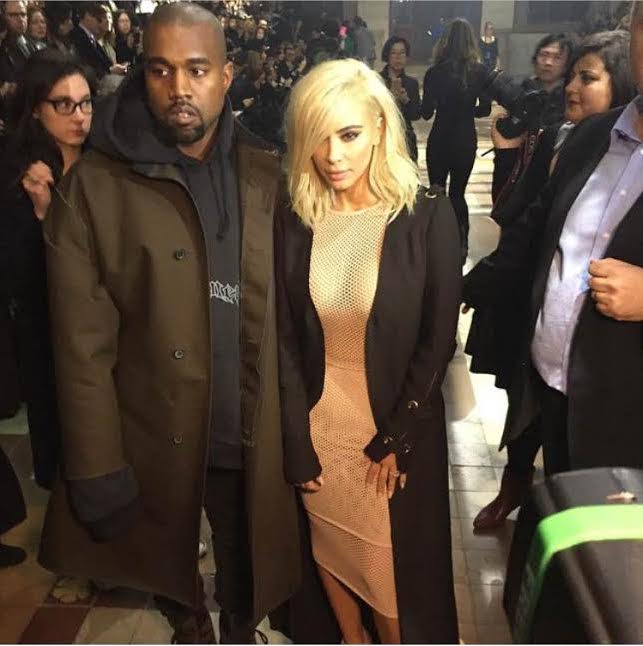 Kim Kardashian West with her hubby in her new hair doo at the Lanvin show today in Paris
