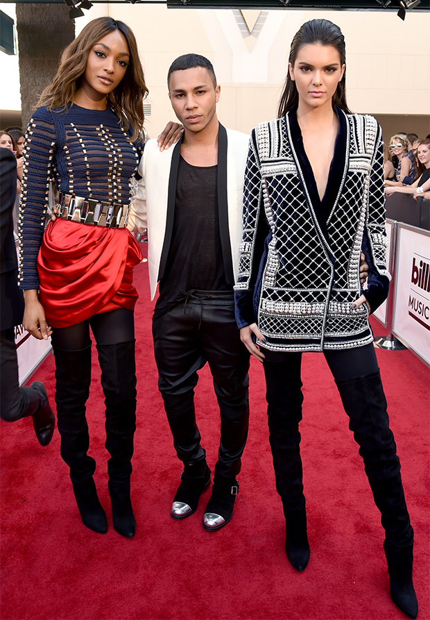 Models Jourdan Dunn and Kendall Jenner with designer Olivier Rousteing in Balmain x H&M